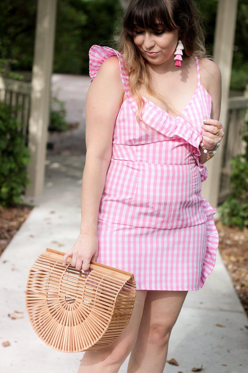 Miami fashion blogger Stephanie Pernas wearing a Boohoo pink gingham dress and Baublebar tassel earrings