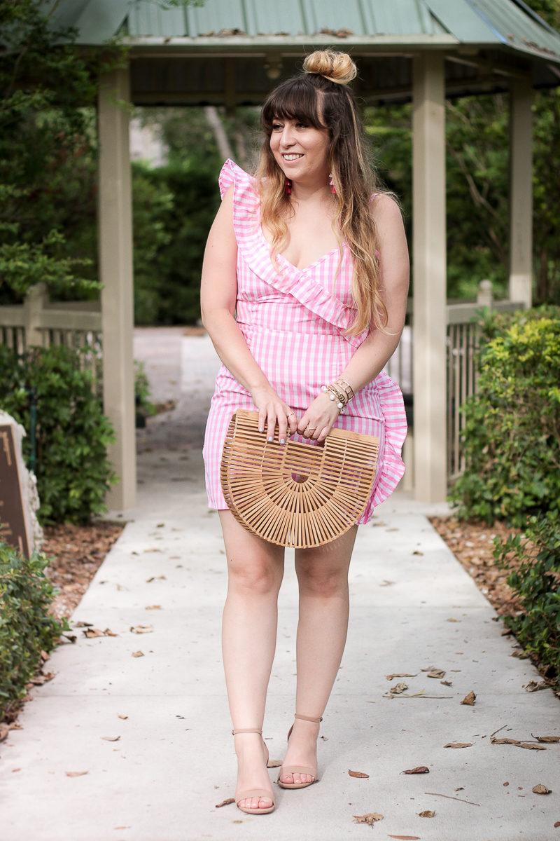 Miami fashion blogger Stephanie Pernas wearing a pink gingham dress