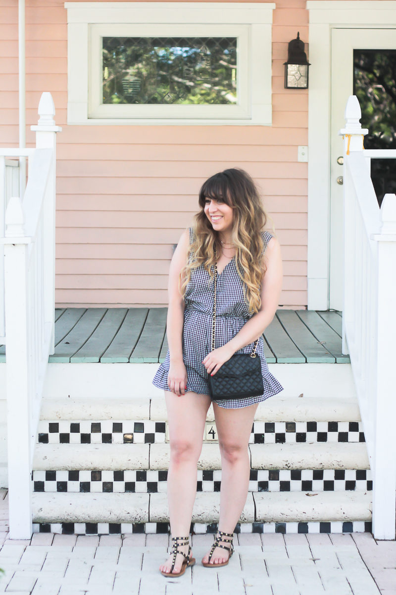 Miami fashion blogger Stephanie Pernas wearing a gingham bow romper for summer