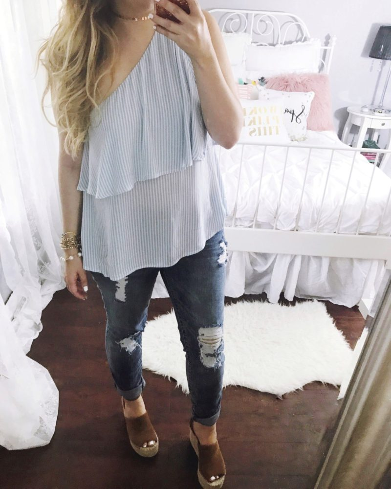 Miami fashion blogger Stephanie Pernas of A Sparkle Factor wearing a stripe one shoulder top and jeans