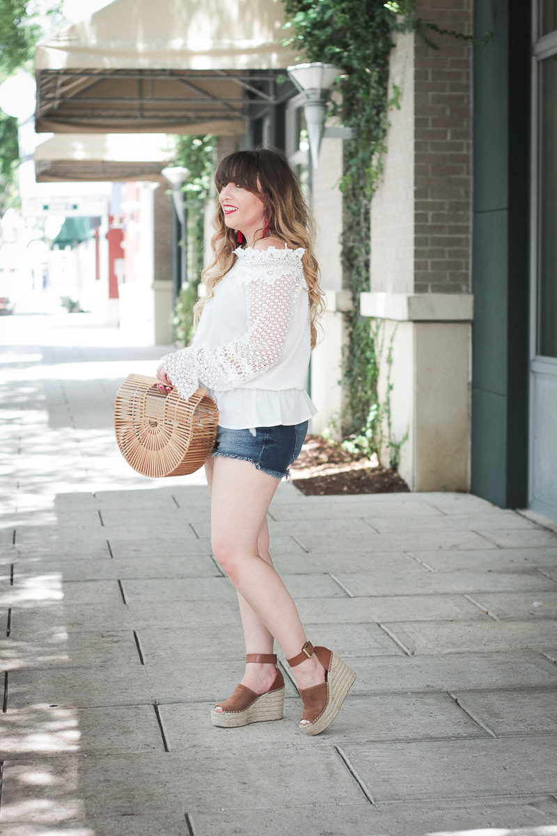 Miami fashion blogger Stephanie Pernas styles a jean shorts outfit idea for summer