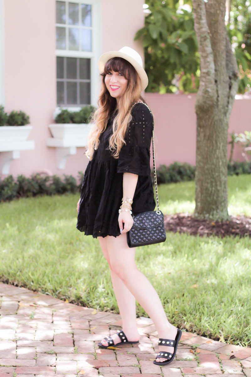 Fashion blogger Stephanie Pernas wearing a cute black dress and sandals for a casual summer outfit idea