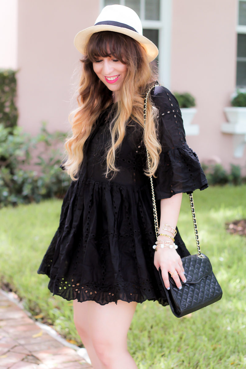 Miami fashion blogger Stephanie Pernas of A Sparkle Factor wearing a black eyelet babydoll dress
