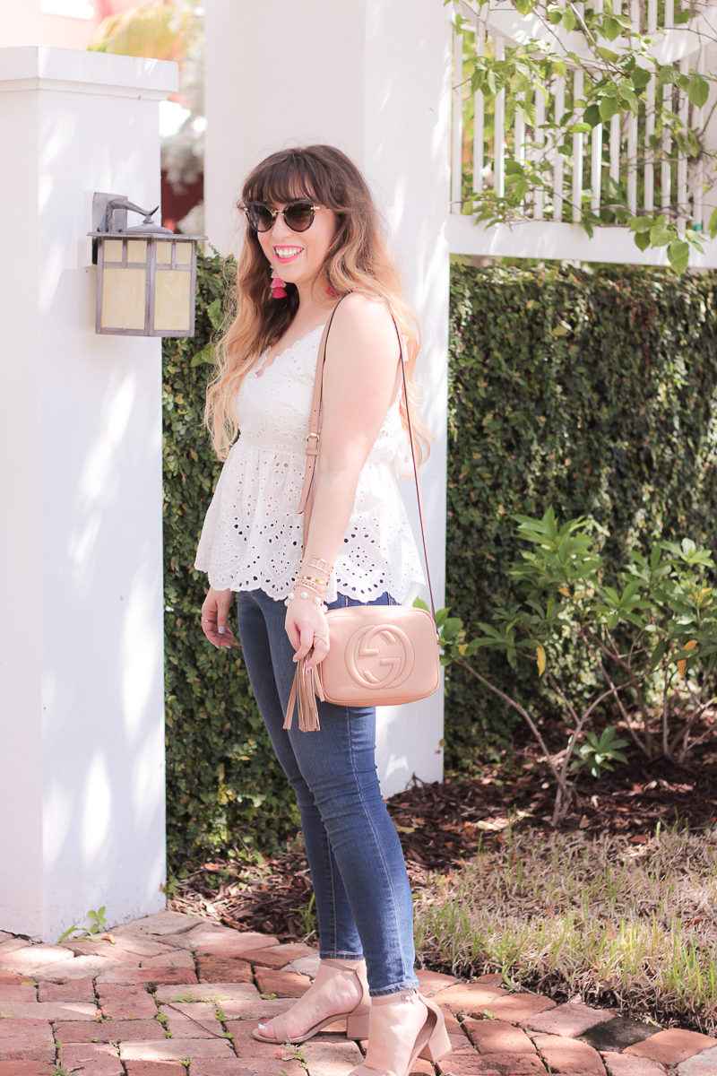 Miami fashion blogger Stephanie Pernas wearing a peplum top and jeans