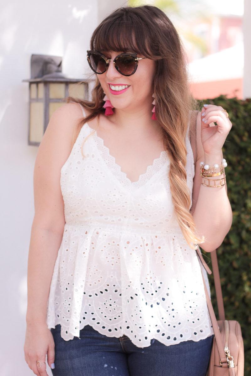 Fashion blogger Stephanie Pernas of A Sparkle Factor wearing an eyelet peplum top