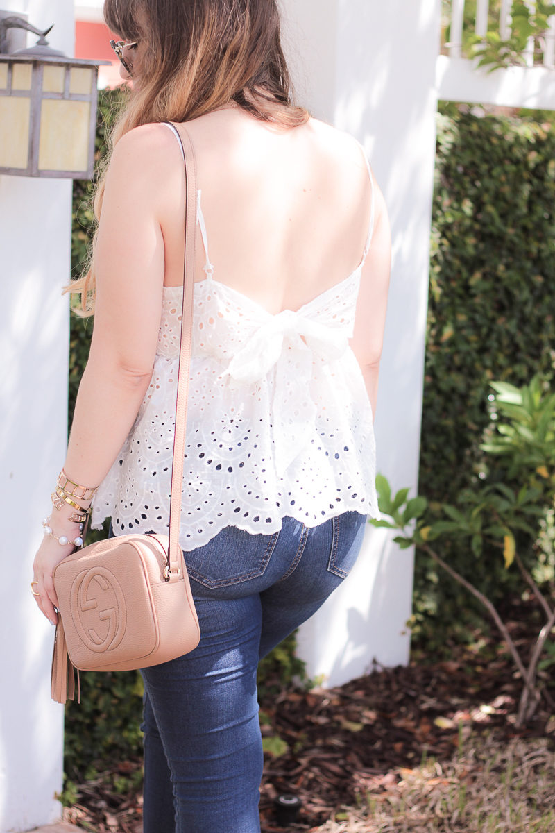 Miami fashion blogger Stephanie Pernas wearing a bow tie back top and Gucci Disco bag