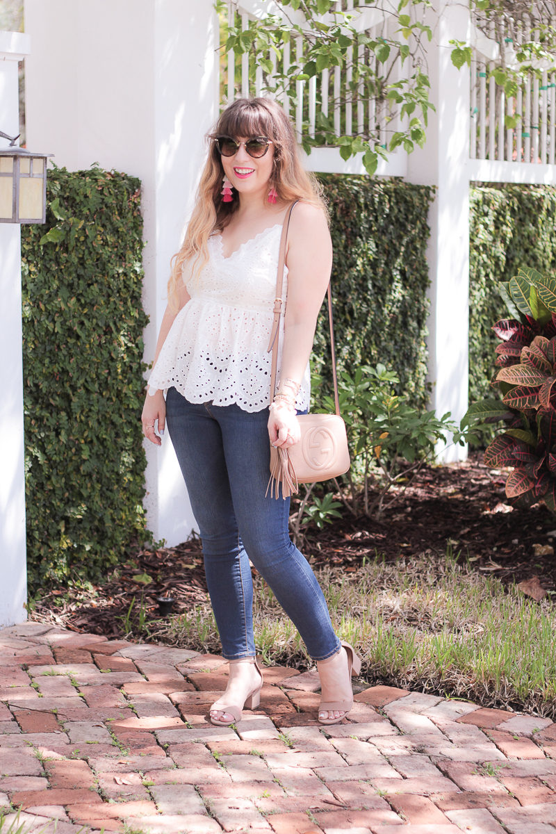 Miami fashion blogger Stephanie Pernas of A Sparkle Factor wearing an eyelet peplum top and jeans for summer