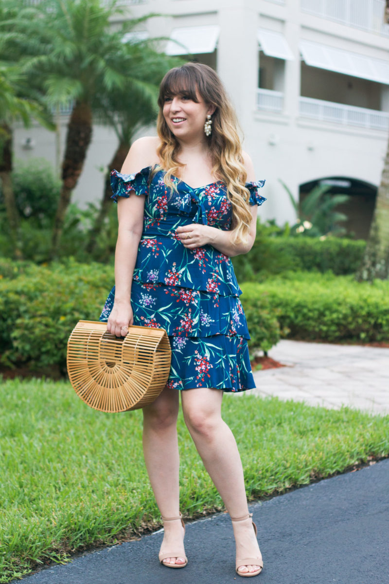 Miami fashion blogger Stephanie Pernas styles an off the shoulder floral dress and pearl earrings