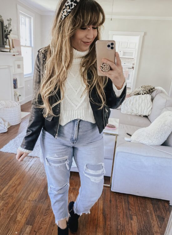 fall outfit idea - leather moto jacket, cropped turtleneck sweater, mom jeans and booties