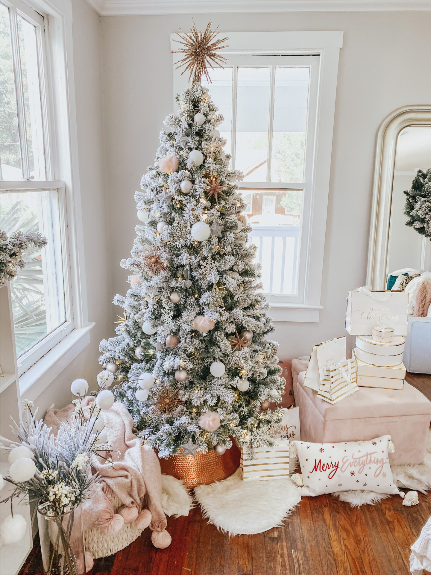 flocked christmas tree and rose gold christmas decorations