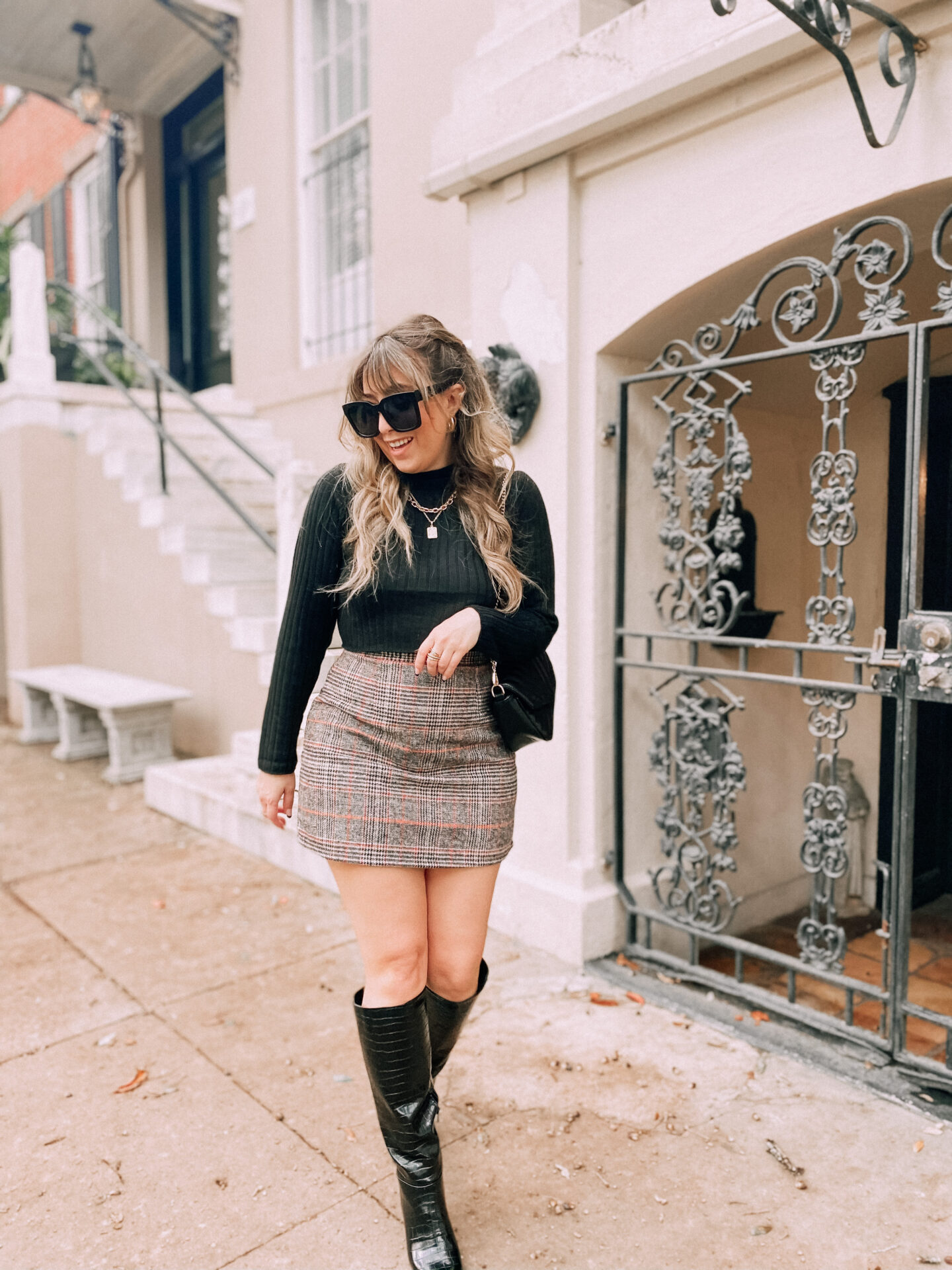 Sharing a chic fall outfit idea -- plaid skirt, knee high allligator boots and a plaid mini skirt