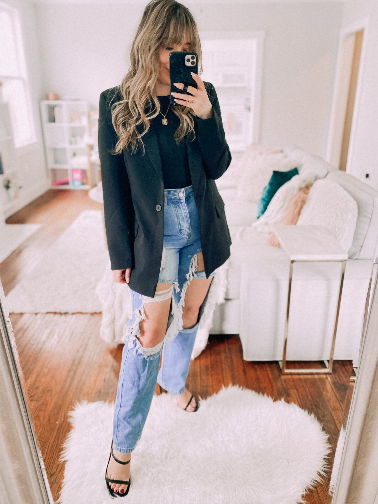 Bodysuit and jeans paired with an oversized blazer